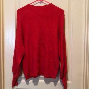 Hot pink puffed sleeve sweater.